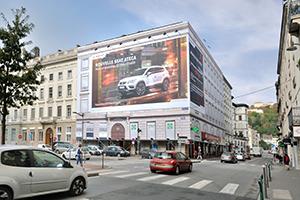Bâche publicitaire sur façade